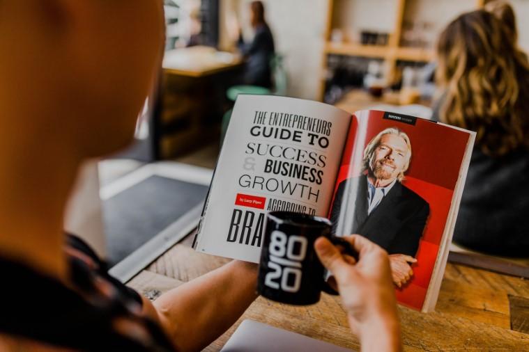 An entrepreneur reading a magazine about entrepreneurship.